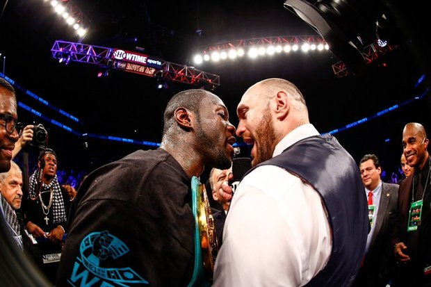 WATCH: Tyson Fury Storms The Ring After Deontay Wilder's KO Just To Harass Him (Video)